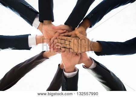 Low Angle View Of Businesspeople Hands Stacking Together Over Each Other