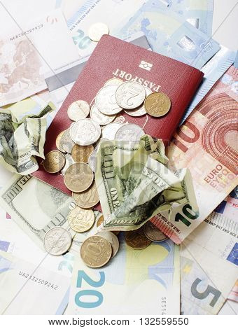 Travel on vacation lifestyle concept: cash money on table in mess with passport and change noone