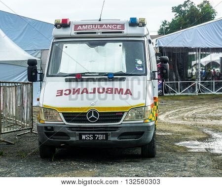 Penampang Sabah Malaysia-May 30, 2016 : Ambulance on standby during outdoor event in Penampang Sabah. Private ambulance is popular among event organizer for first respond and rescue at outdoor event.