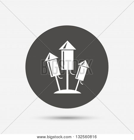 Fireworks rockets sign icon. Explosive pyrotechnic device symbol. Gray circle button with icon. Vector