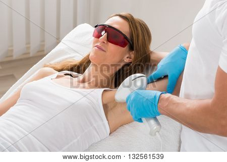 Mature Woman Receiving Underarm Laser Hair Removal Treatment