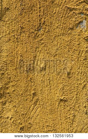 The texture of yellow clay wall for background.