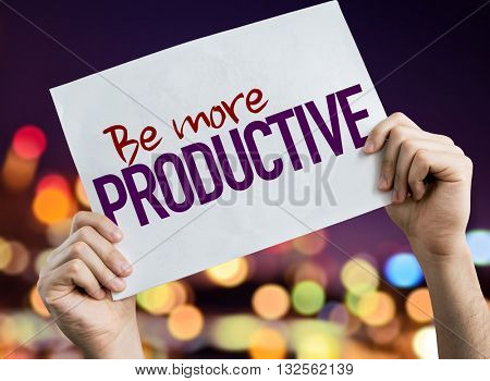 Be More Productive placard with night lights on background