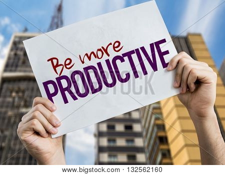 Be More Productive placard with urban background
