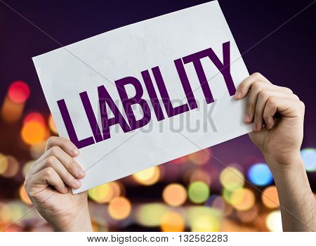 Liability placard with night lights on background