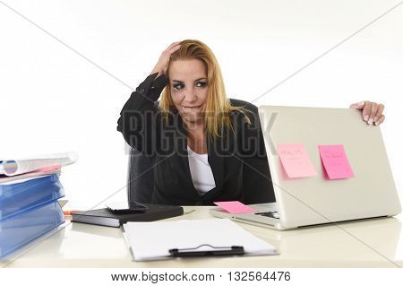 worried attractive businesswoman in stress working with laptop computer at office desk overwhelmed and overworked suffering collapse in frustrated face expression