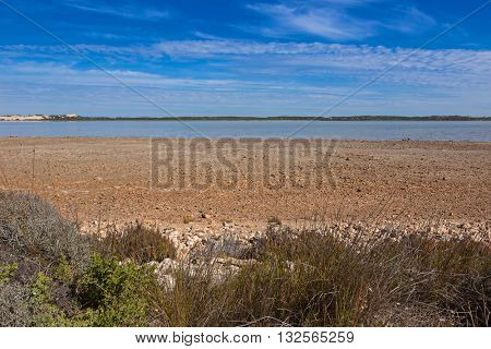 View of the Coorong and sand dune Younghusband Peninsula across the water at Coorong National Park in South Australia