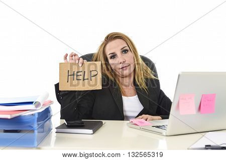 frustrated attractive businesswoman in her 40s holding help sign desparate suffering stress overworked and overwhelmed working at office laptop computer in sad and worried face expression