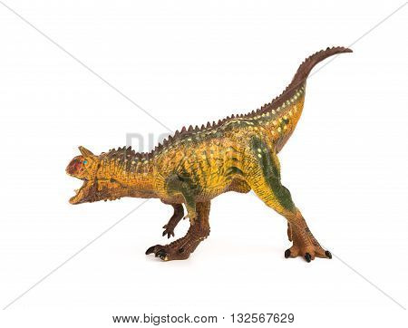 side view brown carnotaurus toy on a white background