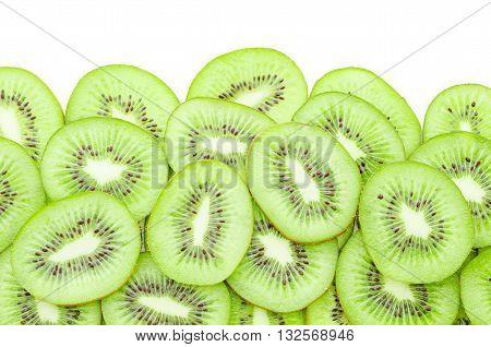 Slices of kiwi fruit on white background.