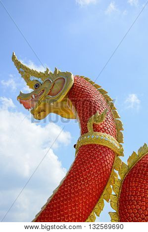 red King of Naga statue on blue sky