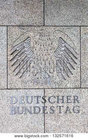 Berlin Germany - May 17 2016: logo of the German Bundestag at a building. The German Bundestag is a constitutional and legislative body of the Federal Republic of Germany