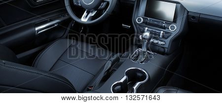 Black leather and chrome parts in car interior