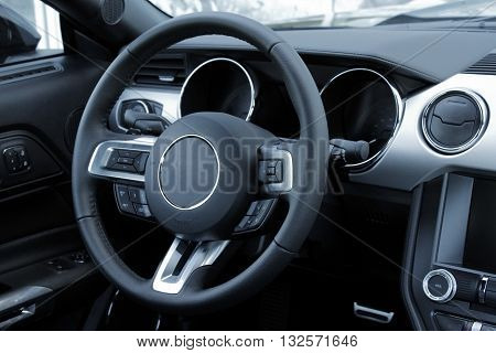 Dashboard and multifunction steering wheel in leather car interior
