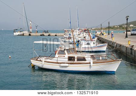 AGISTRI, GREECE - MAY 12, 2016: Boats moored in the harbour at Milos on the Greek island of Agistri. The small Saronic island is just under an hour from Piraeus harbour in Athens.