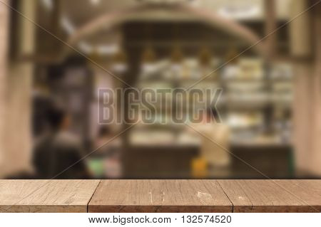 Wooden Table For Display Or Montage Your Product With Blur Background Of Glasses And Bottle Of Alcoh