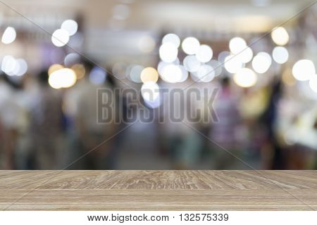 Wooden Table For Display Or Montage Your Product With Blur Background Of People In Department Store