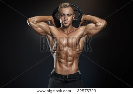 Handsome Athletic Guy Posing With Barbell Plate