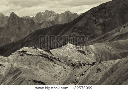 Nice sepia toned rocks of Moonland landscape Leh Jammu Kashmir India. The Moonland part of Himalayan mountain is famous for it's rock formation and texture which looks like a part of moon on earth.