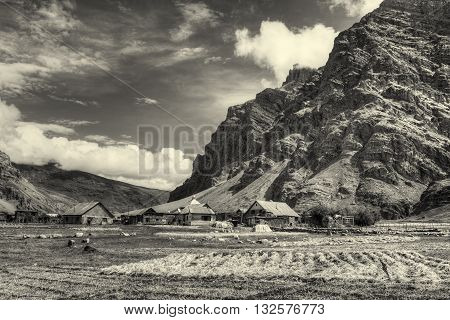 Sceneic view of Drass village with blue cloudy sky background Kargil Ladakh Jammu and Kashmir India Nice Sepia toned image depicting beautiful rural hilly Indian view