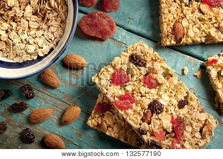 granola bar on a blue wooden table