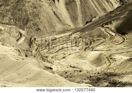 Aerial view of Zigzag road - famously known as jilabi road at old route of Leh Srinagar Highway Ladakh Jammu and Kashmir India. Sepia tinted beautiful stock image