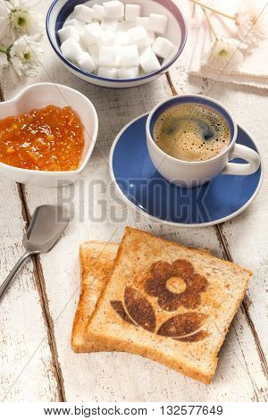 Breakfast, coffee, jam and toast with a flower pattern