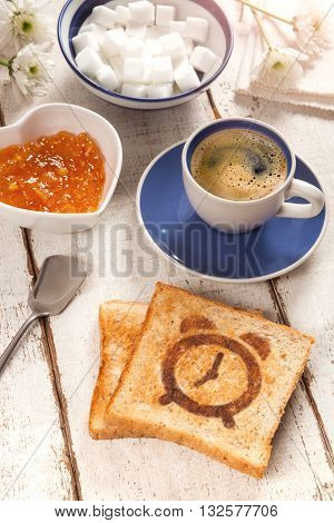 Breakfast, coffee, jam and toast with a alarm clock pattern