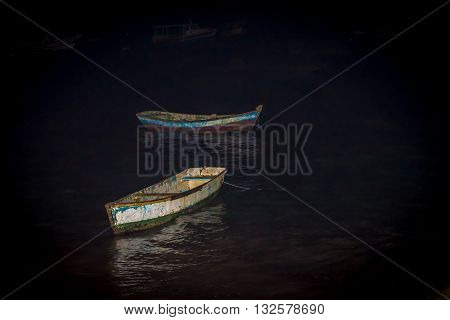 Punt Boat Anchored At The Beach In Sunset