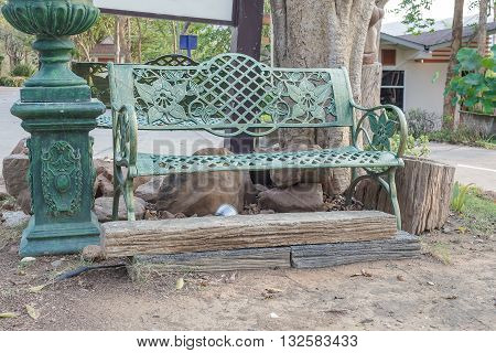 metal Green chair in the garden. Under the tree