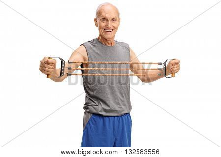 Studio shot of an elderly man exercising with a resistance band isolated on white background