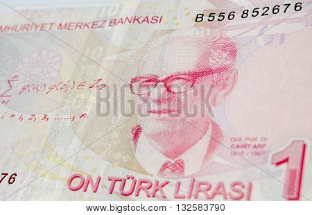 Famous mathematician Professor Dr Cahit Arf on a ten Lira banknote in circulation in Turkey. He is famous for work leading to knot theory and surgery theory. Used banknote photographed at an angle.