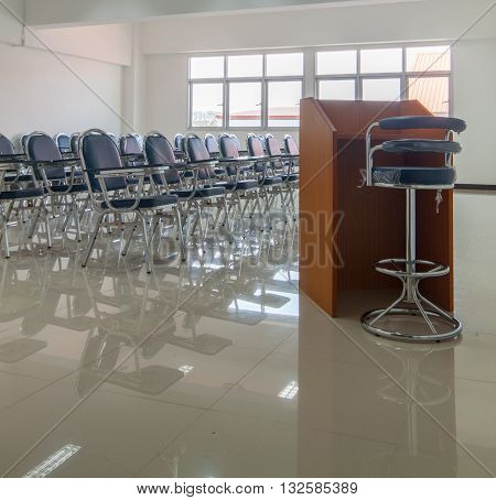 A empty chair class in classroom background