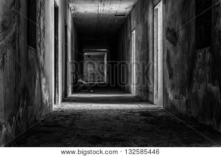 depressed woman sitting on walkway in creepy abandoned building darkness concept