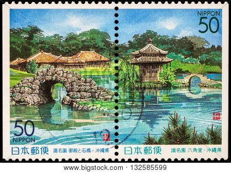 RUSSIA - JUNE 02 2016: A stamp printed in Japan shows japanese garden with pond and bridges series