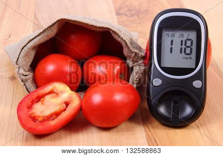 Fresh ripe tomatoes in jute bag and glucose meter on wooden table diabetes healthy lifestyle and nutrition result of measurement of sugar
