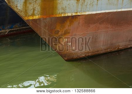 nose fishing trawler with figures on green water