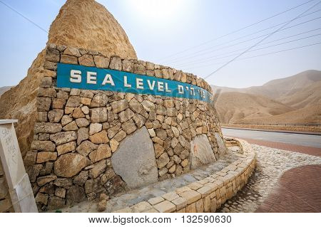 Sea level sign written in 3 languages approaching Dead Sea Israel