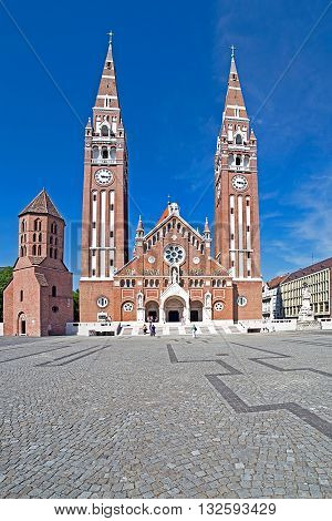 SZEGED HUNGARY - MAY 22 2016: Votive Church of Our Lady of Hungary in Szeged. Construction began in 1913 and it was completed at 1930.