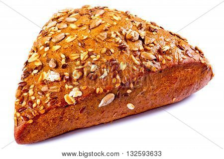 organic rye bun seasoned with flax sesame pumpkin sunflower seeds and peanuts on a white background close-up
