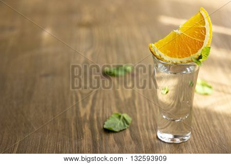 Tequila shot with orange with copypaste space