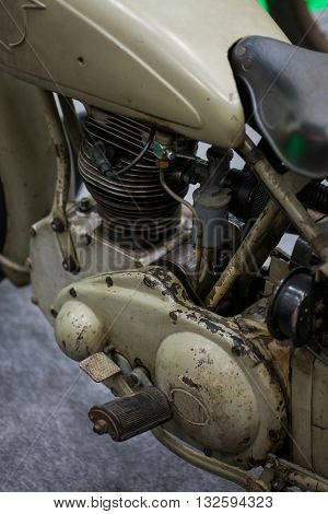 Color detail of the engine of a vintage motorcycle.