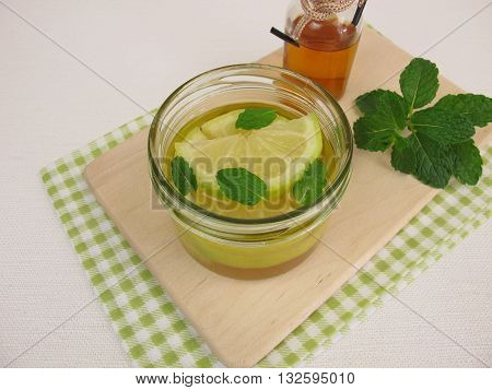 Pickled lemons with mint in vinegar in jar