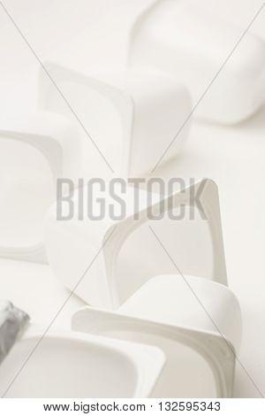 Empty Crushed Plastic Yogurt Pots