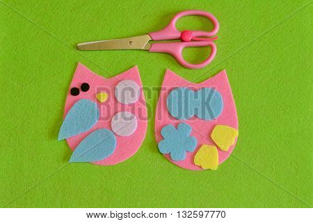 Cut-out details owl toy. Scissors. Fabric crafts for kids step by step. How to make a cute felt bird toy. Sewing pattern. Set to create a baby toy. Fun handmade idea for kids