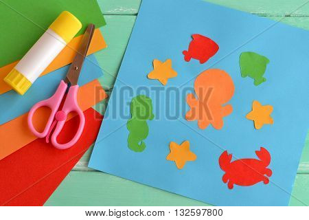 Paper ocean creatures, simple fun applique. Creative sea animal crafts for kids. Kids workshops. Creativity lesson. Scissors, glue stick, pieces of colored paper, stationery for children's art.