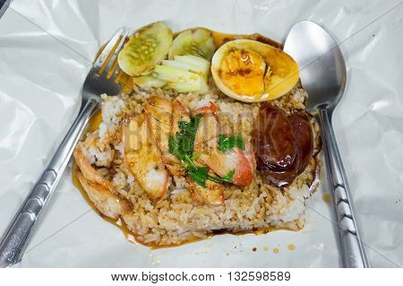 Rice with roasted pork with eggs sausage pork