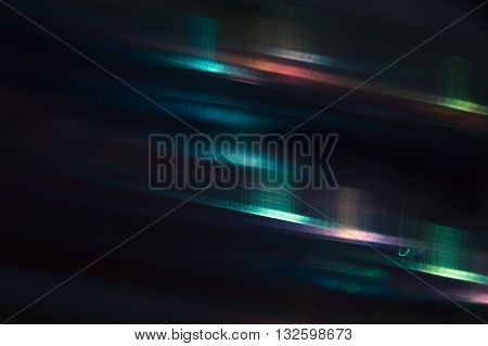 Dark iridescent background with multicolored abstract highlights