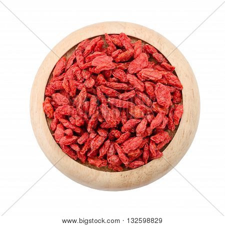 Dried Tibetan goji berries (wolfberry) in wooden dish isolated on white background Save clipping path.