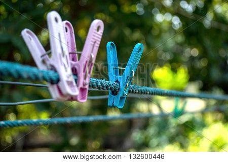 Two Colorful Clothespin Pink And Blue On The Rope. That Represents The Loneliness Of Being Alone. (s
